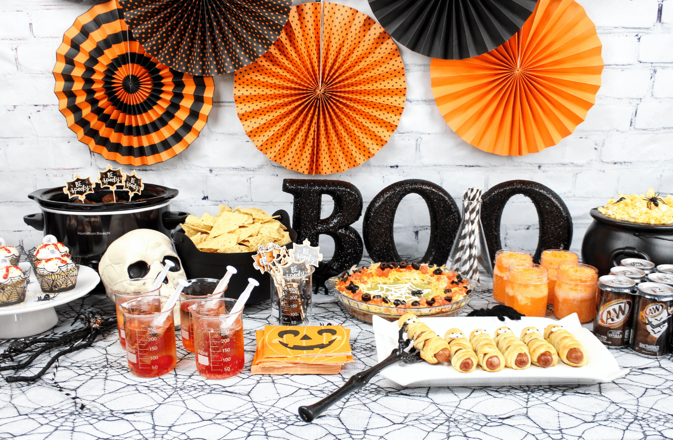 i have a full spread today from hot dog mummies to spiderweb dip to deliciously spooky desserts like eyeball cupcakes made with 7up