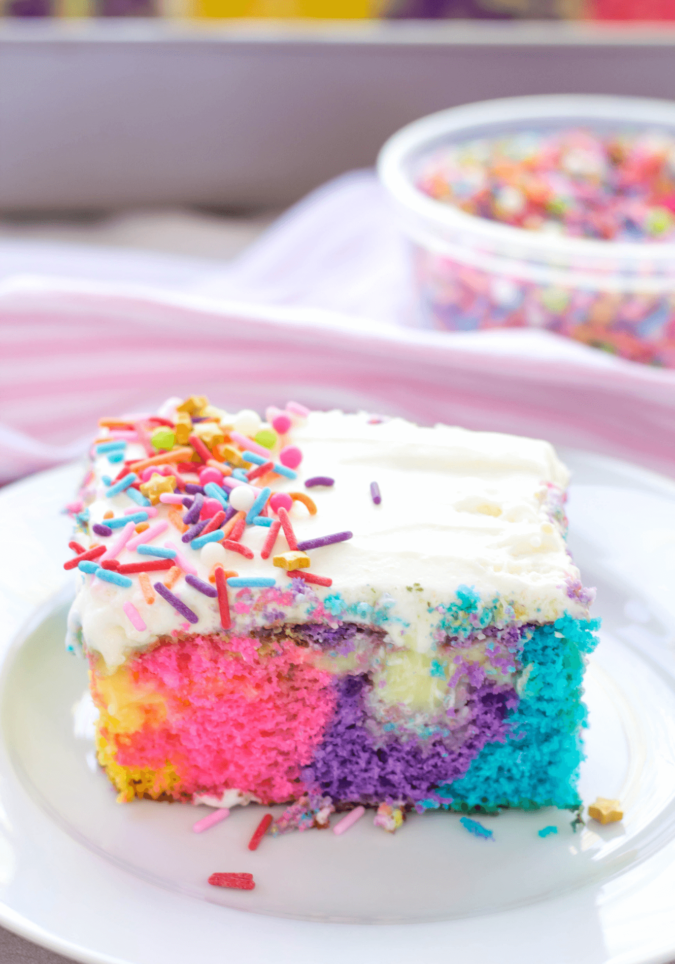 Unicorn Poke Cake, unicorn cake, rainbow cake, poke cake, birthday cake, easy birthday cake, birthday party ideas, fun dessert ideas