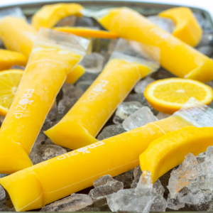 Mango Orange Ice Pops are a great summer treat to keep you cool made with only two ingredients of fresh mango and orange juice. Popsicles | Ice Pop recipe | summer treat | mango dessert