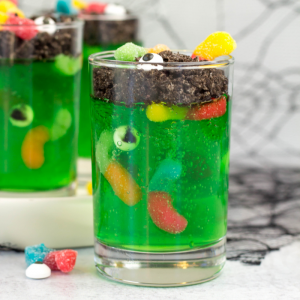 Halloween Jello Worm Cups, jello cups, lime jello, Halloween dessert, Halloween treat, Halloween recipe ideas, worms in dirt recipe, kid friendly Halloween recipe